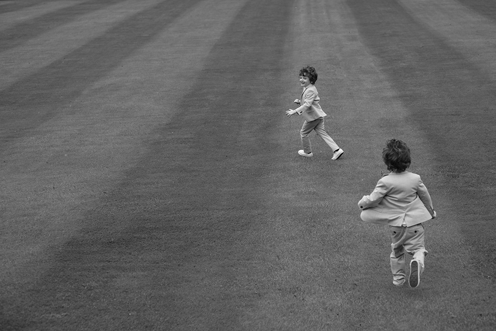 kids running on the grounds of luttrellstown castle wedding