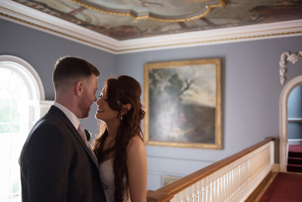 wedding couple kissing on staricase at luttrellstown castle