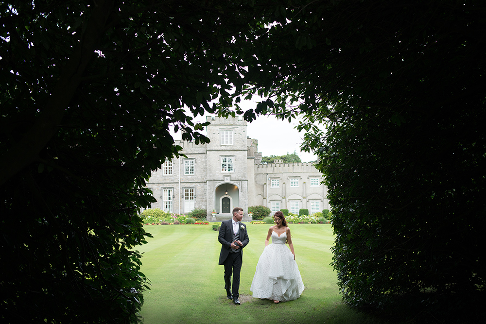 couple enjoy at stroll on grounds of luttrellstown castle wedding
