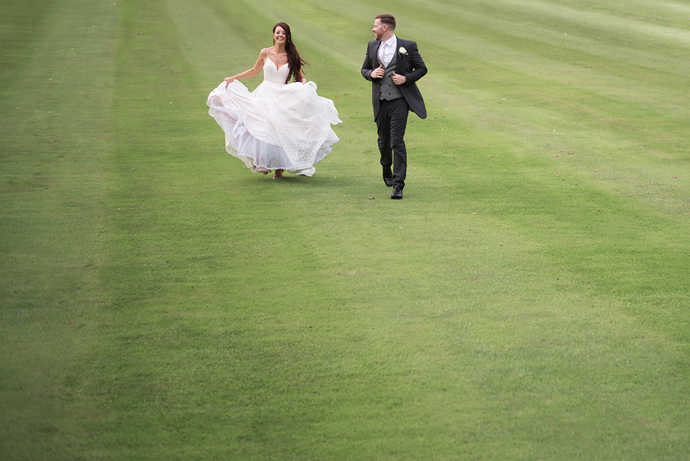 running on the lawn at luttrellstown castle wedding
