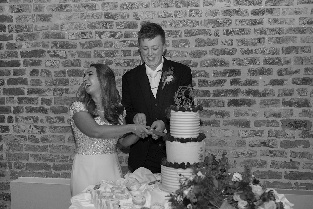 cutting the cake at wedding at farnham estate cavan