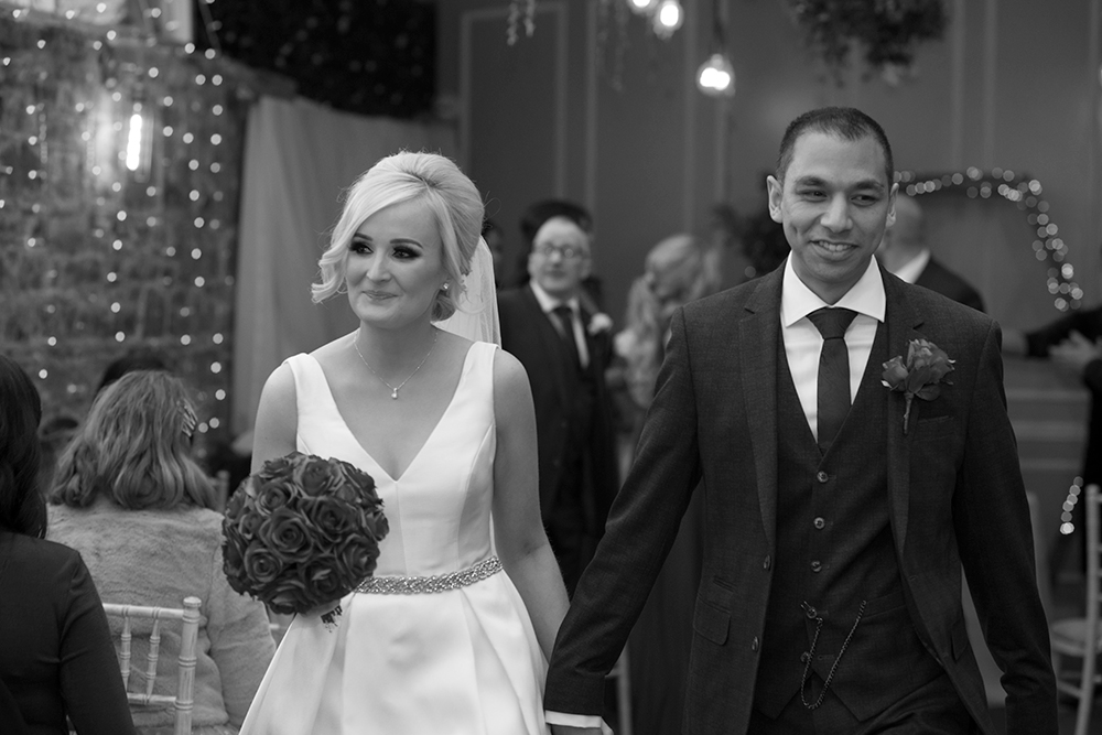 coming down the aisle at wedding ceremony at boyne hill house estate wedding