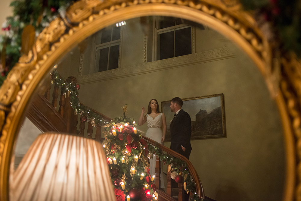 bride and groom on staircase at tankardstown house