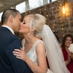 bride and groom kiss at boyne hill house wedding ceremony