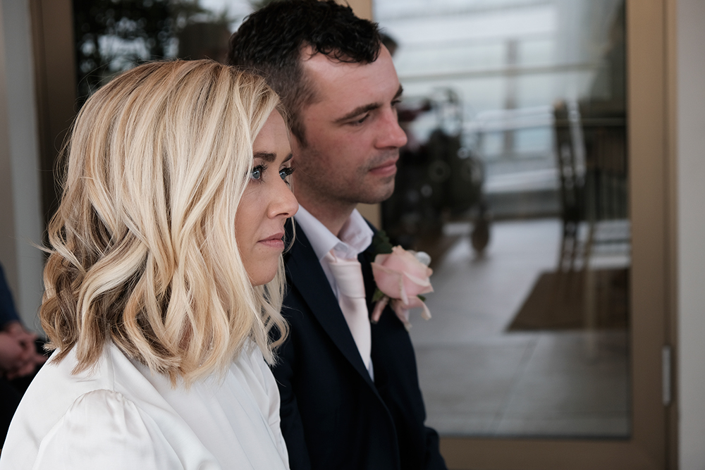 wedding couple during ceremony at The Baths in Clontarf
