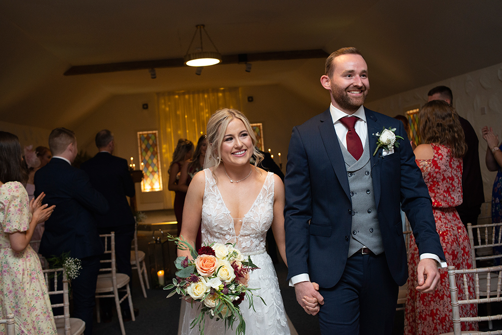 bride and groom walking down the aisle Rathsallagh House
